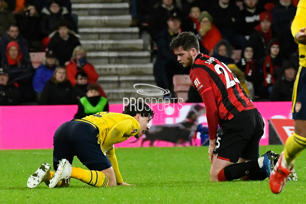 Hector Bellerin (2) of Arsenal down in agony after a collision with Jack Simpson (25) of AFC Bournemouth during the The FA Cup match between Bournemouth and Arsenal at the Vitality Stadium, Bournemouth, England on 27 January 2020.