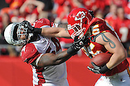 Tight end Jake O'Connell #85 of the Kansas City Chiefs stiff-arms linebacker Gerald Hayes #54 of the Arizona Cardinals, after picking up 18-yards for a first down during the second quarter at Arrowhead Stadium in Kansas City, Missouri.