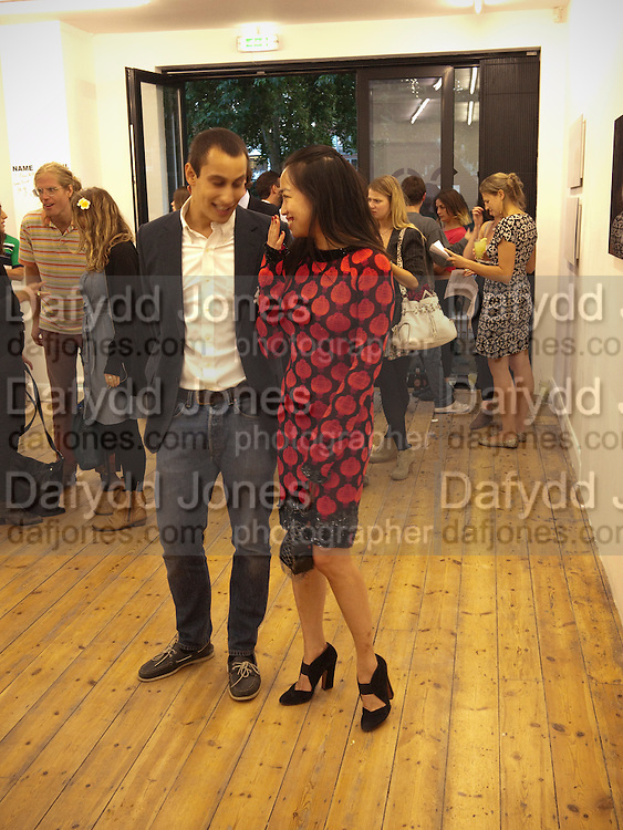 """ALEX DELLAL; YI ZHOU, Video artist Yi Zhou  first solo show """"I am your Simulacrum"""".Exhibition opening at 20 Hoxton Square Projects. Hoxton Sq. London. 1 September 2010.  -DO NOT ARCHIVE-© Copyright Photograph by Dafydd Jones. 248 Clapham Rd. London SW9 0PZ. Tel 0207 820 0771. www.dafjones.com."""