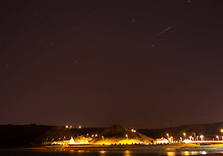 © Licensed to London News Pictures. 24/12/2013<br /> <br /> Saltburn, Cleveland, United Kingdom<br /> <br /> The International Space Station passes over Saltburn in Cleveland on Christmas Eve.<br /> <br /> Photo credit : Ian Forsyth/LNP