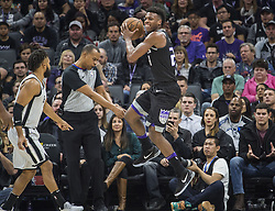 December 23, 2017 - Sacramento, CA, USA - The Sacramento Kings' Buddy Hield (24) reacts to stepping out of bounds against the San Antonio Spurs on Saturday, Dec. 23, 2017, at Golden 1 Center in Sacramento, Calif. (Credit Image: © Hector Amezcua/TNS via ZUMA Wire)