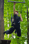 Town of Wallkill, New York - Sofia Macaluso, leaps off a 23-foot-high platform to grab a trapeze bar during a Ninja Warrior Day Camp trip to Ring Homestead Camp on July 8, 2014.