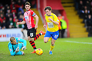 GOAL.  Accrington Stanley's Shay McCartan goes around Exeter City's Robert Olejnik to open the scoring during the Sky Bet League 2 match between Exeter City and Accrington Stanley at St James' Park, Exeter, England on 23 January 2016. Photo by Graham Hunt.
