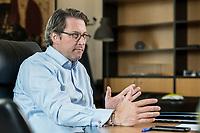 03 JUL 2019, BERLIN/GERMANY:<br /> Andreas Scheuer, CSU, Bundesminister fuer Verkehr und digitale Infrastruktur, waehrend einem Interview, in seinem Buero, Bundesministerium fuer Verkehr und digitale Infrastruktur<br /> IMAGE: 20190703-01-051
