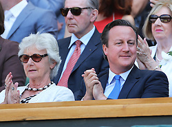 Prime Minister David Cameron and his mother Mary in the Royal Box for the Men's Final at the Wimbledon Tennis Championships in  London, Sunday, 7th July 2013<br /> Picture by Stephen Lock / i-Images
