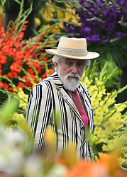 © Licensed to London News Pictures. 20/05/2013. London, UK Sir Roy Strong walks amongst the flowers. Press day at Chelsea Flower Show 2013. The centenary edition of the show attracts large number of visitors and is already sold out before opening day. Photo credit : Stephen Simpson/LNP