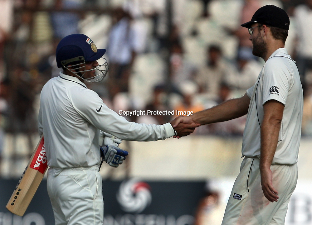 Indian Batsman Virender Sehwag shekh hand with New Zealand Captain Daniel Vettori after end of the day during the Indian vs New Zealand 2nd test match day-5 Played at Rajiv Gandhi International Stadium, Uppal, Hyderabad 16 November 2010 (5-day match)
