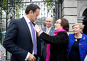 Repro Free: 15/10/2014 <br /> Kathleen O'Meara, head of advocacy and communications pins a pink ribbon onto the Minister for Health Leo Varadkar T.D. as staff and supporters of the Irish Cancer Society gathered outside Leinster House to welcome the Government&rsquo;s decision to make the necessary investment to ensure BreastCheck will be extended to women aged between 65-69 years of age. The extension of screening to this age group will save a minimum of 87 lives per year.<br /> The Society has been campaigning for women in the 65-69 age group to be screened for breast cancer since 2011. One in ten of all breast cancers occur in women of this age.  The International Agency for Research on Cancer (IARC) says that quality screening mammography carried out every two years in women who are 50-69 years of age should reduce their risk of dying from breast cancer by about 35%. Picture Andres Poveda