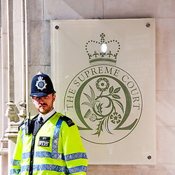 LONDON, UK - 30th May 2012: a policeman stands guard outside the Supreme Court in central London, minutes after Assange's loss of his extradition appeal.