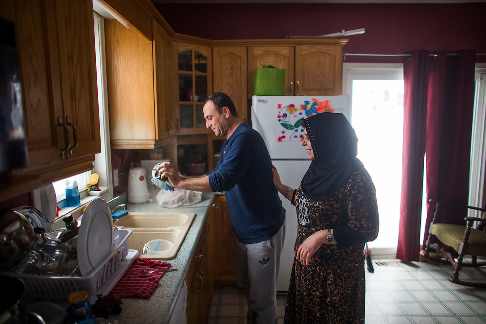 Syrian Refugee Abdel Malek Al Jasem and his wife Sawsan use the sink in their kitchen of their temporary home in Picton, Ontario, Canada, Wednesday January 20, 2016.   (Mark Blinch for the BBC)