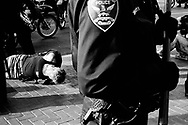 Exhausted demonstrator awaiting to be transported after being arrested, San Francisco, 2004