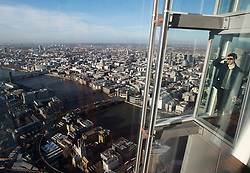 **PICTURES STRICTLY EMBARGOED INTIL 00:01 HOURS FRIDAY 11 JANUARY 2013** © London News Pictures. London, UK.  A man looking at the London Skyline during a media preview of the top viewing level of The Shard building in London ahead of the public opening of 'A View From The Shard' on February 1, 2013. The public can view a 360 degree view of the capital from the 72nd floor of Western Europe's tallest building which stands at 800ft (244m).  Photo credit : Ben Cawthra/LNP