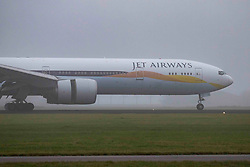 November 16, 2018 - Amsterdam, Netherlands - Jet Airways Boeing 777-300 in the mist at Amsterdam Schiphol International Airport. The aircraft registration is VT-JEQ and is a Boeing 777-300 ER or 777-35R(ER). Jet Airways uses Amsterdam as a hub and connects AMS to Bengaluru, Delhi, Mumbai and Toronto Pearson. The airline operates a fleet of 124 aircraft, 10 of them are Boeing 777 and has 230 more on order. The aircraft arrived from Toronto and landed in 18R in fog or the famous Polderbaan runway. (Credit Image: © Nicolas Economou/NurPhoto via ZUMA Press)