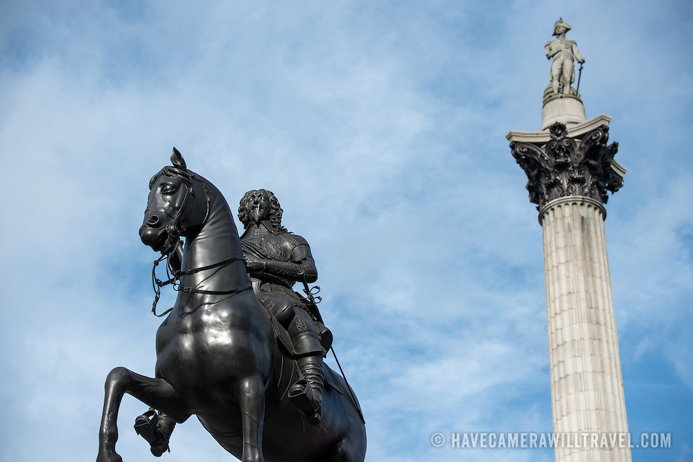 Statue of Admiral Horatio Nelson that sits atop Nelson's Column in Trafalgar Square in central London. In the foreground is a statue of King Charles I on horseback.