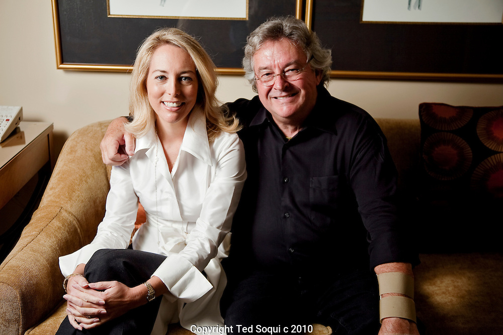 Valerie Plame-Wilson and Joe Wilson posing inside a Four Seasons Hotel in Beverly Hills.