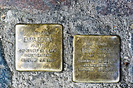 These cobbles are placed before buildings from which Jews and other people were taken and sent to their deaths in concentration camps. Thousands and thousands of them dot the pavements of the city. Berlin, Germany.