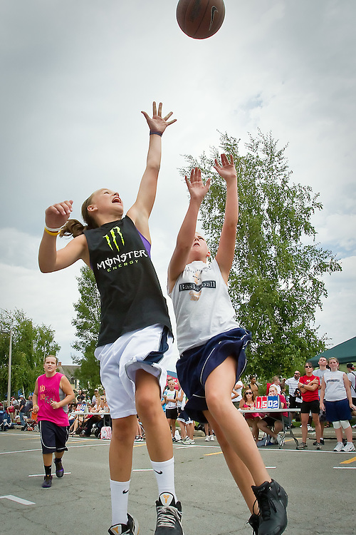 Riley Lupfer, 12, goes up for a loose ball near the top of the key during the Coeur d'Alene 3-on-3 basketball shootout Saturday, Aug. 21, 2010 at North Idaho College.