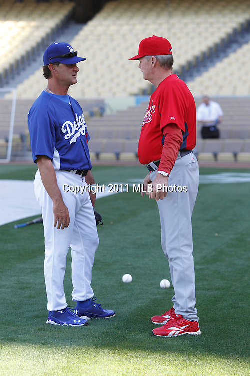 LOS ANGELES, CA - APRIL 15:  Manager Don Mattingly #8 (left) of the Los Angeles Dodgers talks to pitching coach Dave Duncan #18 of the St. Louis Cardinals during the game between the St. Louis Cardinals and the Los Angeles Dodgers on Friday April 15, 2011 at Dodger Stadium in Los Angeles, California. (Photo by Paul Spinelli/MLB Photos via Getty Images) *** Local Caption *** Don Mattingly;Dave Duncan