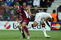 Rui Pedro (L) of CFR Cluj challenges Custodio (R) of Manchester United during the UEFA Champions League, Group H, soccer match at Dr. Constantin Radulescu Stadium in Cluj-Napoca, Romania, 2 October 2012.