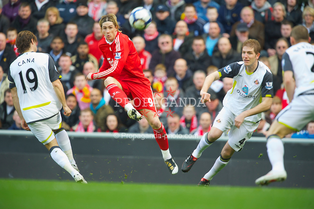 LIVERPOOL, ENGLAND - Sunday, March 28, 2010: Liverpool's Fernando Torres scores a spectacular opening goal against Sunderland, as Lorik Cana and Michael Turner can only watch on in admiration, during the Premiership match at Anfield. The goal was reminicent of John Barnes' magnificent goal against Oldham Athletic on the opening day of the 1991/92 season. (Photo by: David Rawcliffe/Propaganda)