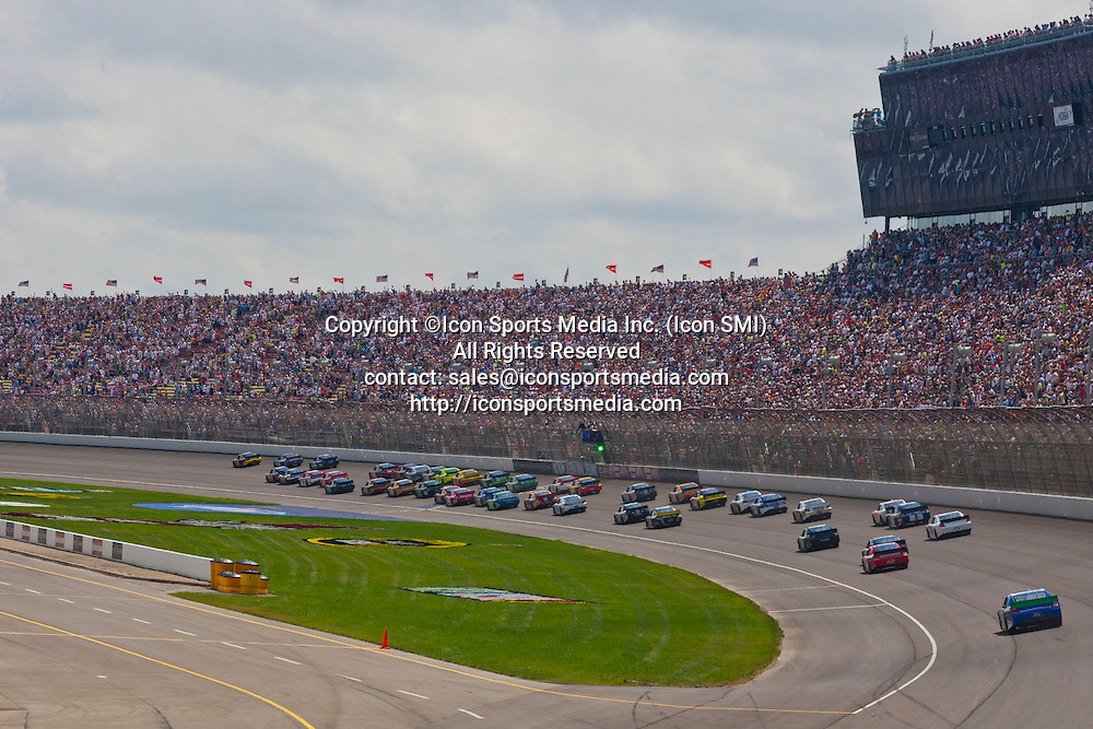 17 June 2012: The field of contending vehicles get the green light for a restart after caution during the NASCAR Sprint Cup Series Quicken Loans 400 at Michigan International Speedway in Brooklyn, MI.