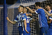 Brighton striker, Anthony Knockaert (27) celebrates his goal with Brighton central midfielder, Beram Kayal (7) and Brighton central defender, Lewis Dunk (5) in front of the Brighton fans during the Sky Bet Championship match between Brighton and Hove Albion and Fulham at the American Express Community Stadium, Brighton and Hove, England on 15 April 2016.