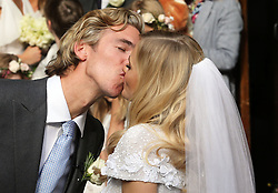 James Cook kisses his new wife Poppy Delevingne after their  wedding at St.Paul's Church in Knightsbridge, London , Friday, 16th May 2014. Picture by Stephen Lock / i-Images