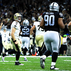 Sep 11, 2016; New Orleans, LA, USA;  New Orleans Saints quarterback Drew Brees (9) celebrates after a 98 yard touchdown during the third quarter of a game against the Oakland Raiders at the Mercedes-Benz Superdome. The Raiders defeated the Saints 35-34. Mandatory Credit: Derick E. Hingle-USA TODAY Sports