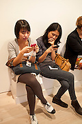 ISHA HENING; AIRI WULAN, Indonesian Eye Contemporary Art Exhibition Reception, Saatchi Gallery. London. 9 September 2011. <br /> <br />  , -DO NOT ARCHIVE-© Copyright Photograph by Dafydd Jones. 248 Clapham Rd. London SW9 0PZ. Tel 0207 820 0771. www.dafjones.com.