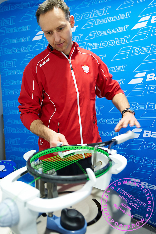 Stringer Piotr Chomicki of Poland while his work during training session one day before the Davies Cup / Group I Europe / Africa 1st round tennis match between Poland and Lithuania at Orlen Arena on March 5, 2015 in Plock, Poland<br /> Poland, Plock, March 5, 2015<br /> <br /> Picture also available in RAW (NEF) or TIFF format on special request.<br /> <br /> For editorial use only. Any commercial or promotional use requires permission.<br /> <br /> Mandatory credit:<br /> Photo by &copy; Adam Nurkiewicz / Mediasport
