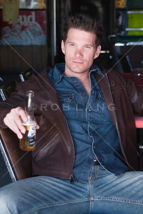 all american man sitting in a bar