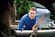King County Sheriff deputy Sam Speight asks Clayton Leady, center, if he has seen Christian Henderson, 10, who went missing earlier in the day Thursday, Oct. 11, 2007. The boy was believed to have ran away from his home in Kent, Wash, when he did not show up for school that day. Speight drove around the neighborhood close to Henderson's home in hope of finding the boy. .