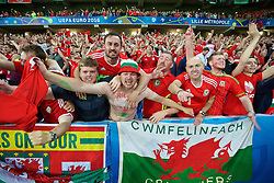LILLE, FRANCE - Friday, July 1, 2016: Wales' supporters celebrate after a 3-1 victory over Belgium and reaching the Semi-Final during the UEFA Euro 2016 Championship Quarter-Final match at the Stade Pierre Mauroy. (Pic by David Rawcliffe/Propaganda)