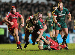 Leicester Tigers lock, Geoff Parling is tackled by Scarlets tighthead prop, Peter Edwards - Photo mandatory by-line: Dougie Allward/JMP - Mobile: 07966 386802 - 16/01/2015 - SPORT - Rugby - Leicester - Welford Road - Leicester Tigers v Scarlets - European Rugby Champions Cup