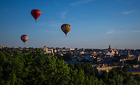 Vilnius, Lithuania- June, 2015: Hot air balloons rise over the old town of Vilnius, which was recognized as an UNESCO World Heritage site in 1994. While much of the surrounding area still bears the marks of the Soviet days, the old town offers vibrant new offerings on a backdrop of Gothic, Renaissance, Baroque and classical architecture. CREDIT: Chris Carmichael for The New York Times