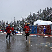 "Competitors warm up during the Bobsleigh Four-man competition  at The Whistler Sliding Centre, Whistler, during the Vancouver Winter Olympics. 26th February 2010. Photo Tim Clayton..'BOB'..Images from the Four-man Bobsleigh Competition. Winter Olympics, Vancouver 2010..History was made at the Whistler Sliding Centre when the USA four-man bobsleigh team, led by Steven Holcomb took the Gold. The first time since 1948, a gap of 62 years, since the USA have won an Olympic Bobsleigh gold and they did it with their sleigh named ""Night Train""...The four days of practice and competition show the tension, nervousness and preparation as the teams of hardened men cope with the challenge of traveling at average speeds of over 150 km an hour. Indeed, five teams had already pulled out of the event before the opening heats because of track complexity, speed and fear, and on the final day, another four teams did not start after six crashes in the first two heats...Teams warm up behind the start complex, warming muscles in the cold in preparation for the explosive start. Many teams prepare in silence, mentally preparing themselves as they wait at the top of the run, in the bobsleigh sheds and the loading areas for their turn. When it's time to slide each team performs it's own starting ritual, followed by the much practiced start out of the blocks for just over four seconds, the teams are then in the hands of the accomplished drivers as they hurtle down the track for just over fifty seconds...Spectators clamber for the best position on track to see the sleighs for a split second, many unsuccessfully try to capture the moments on camera, The rumble of the sleigh is heard then the crowds gasp as it hurtles past in a blur...The American foursome of  Steven Holcomb, Justin Olsen, Steve Mesler and Curtis Tomasevicz finished with a pooled four-heat time of 3min 24.46sec. The German team led by Andre Lange won the Silver Medal in a combined time of 3min 24.84sec while the Bronze Medal went"