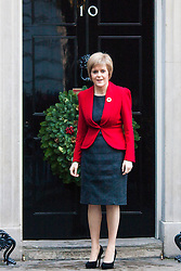 London, December 15th 2014. Northern Ireland's first and deputy first ministers join Scottish and Welsh leaders for Joint Ministerial Committee talks with David Cameron in Downing Street. The talks come three days after Cameron's offer of a financial package for the Northern Ireland Executive was rejected by Stormont. PICTURED: Scotland First Minister Nicola Sturgeon emerges from Number Ten.