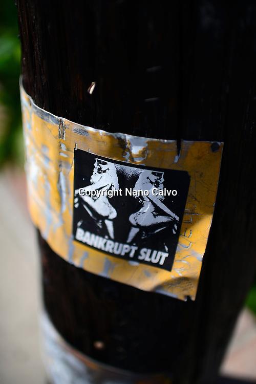 """Sticker reads """"Bankrupt Slut"""", Los Angeles."""