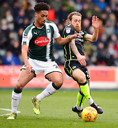 Zak Vyner of Plymouth Argyle challenges Stuart Sinclair of Bristol Rovers - Mandatory by-line: Dougie Allward/JMP - 17/03/2018 - FOOTBALL - Home Park - Plymouth, England - Plymouth Argyle v Bristol Rovers - Sky Bet League One