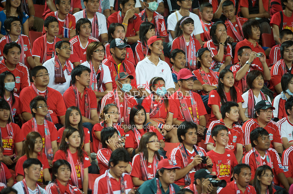 BANGKOK, THAILAND - Wednesday, July 22, 2009: Thai Liverpool supporters wearing swine flu masks during a preseason friendly match against Thailand at the Rajamangala Stadium. (Pic by David Rawcliffe/Propaganda)