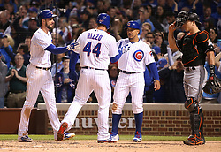 June 6, 2017 - Chicago, IL, USA - The Chicago Cubs' Anthony Rizzo (44) is congratulated by teammates Kris Bryant, left, and Jon Jay after Rizzo hit a three-run home run in the fifth inning against the Miami Marlins at Wrigley Field in Chicago on Tuesday, June 6, 2017. (Credit Image: © Chris Sweda/TNS via ZUMA Wire)