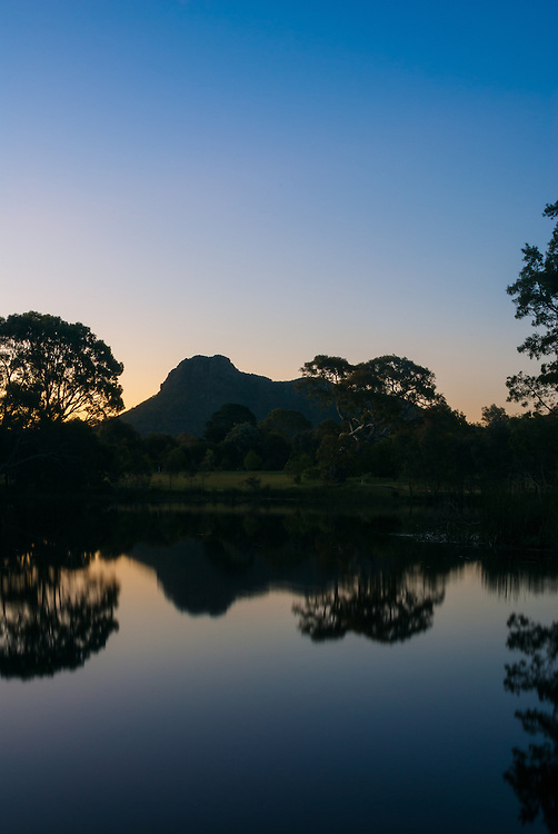 Grampians Mountain Range seen from Dunkeld reflected in a lake at dusk