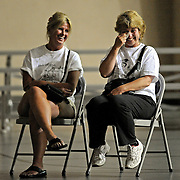 Shari MacLeod laughs as Brenda Young wipes away tears as a speaks talks during a memorial service for their father, Graceland Too owner Paul MacLeod, in Holly Springs, Miss., Tuesday, Aug. 12, 2014. (Photo/Thomas Graning)