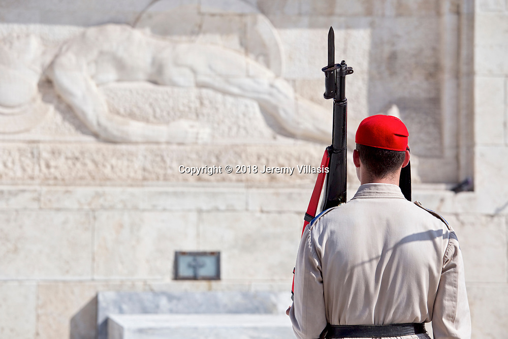 An Evzones of the Presidential Guard at the war memorial of the Tomb of the Unknown Soldier in the heart of modern Athens, Greece.