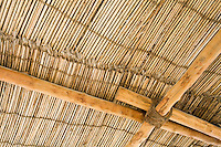 Dubai UAE Detail of a wood thatch roof at the Heritage House Museum in Deira.