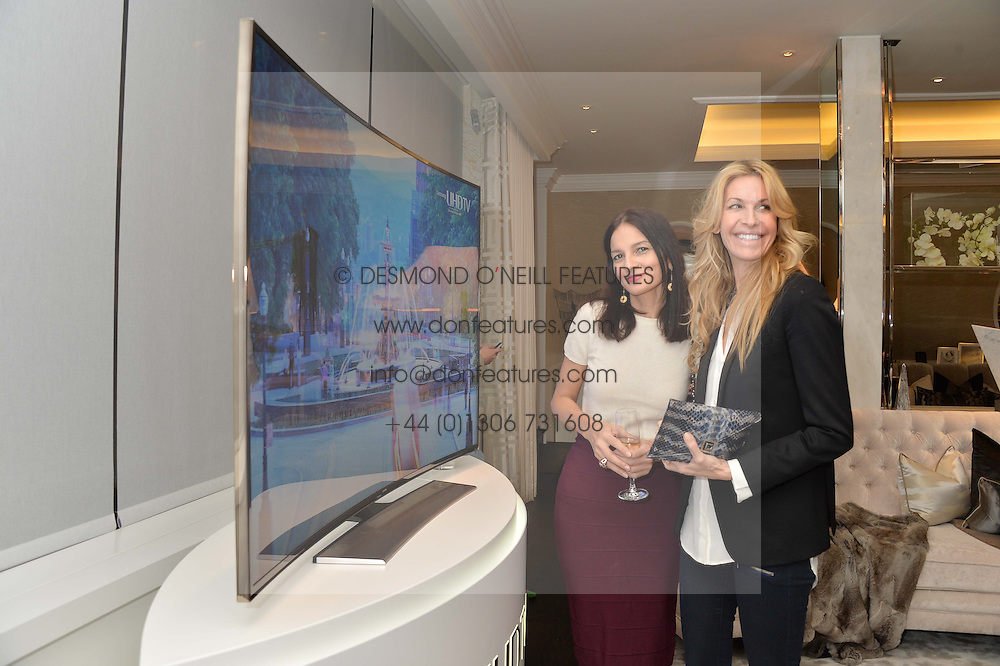 First look of the new Samsung Curved UHD TV at the Candy & Candy penthouse at No. 1 Arlington Street, London - an exclusive Samsung BlueHouse event held on 27th February 2014.<br /> Picture shows:-Left to right, YASMIN MILLS and MELISSA ODABASH.
