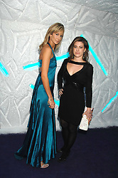 Left to right, LADY VICTORIA HERVEY and FRANCESCA VERSACE at La Dolce Vita Christmas Ball in aid of DeBRa held at Battersea's Evolution, Battersea Park, London on 12th December 2007.<br />