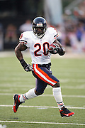 CANTON - AUGUST 8:  Running back Thomas Jones #20 of the Chicago Bears in action against the Miami Dolphins at Pro Football Hall of Fame Field at Fawcett Stadium in Canton, Ohio on August 8, 2005. The Bears defeated the Dolphins 27-24. ©Paul Anthony Spinelli *** Local Caption *** Thomas Jones
