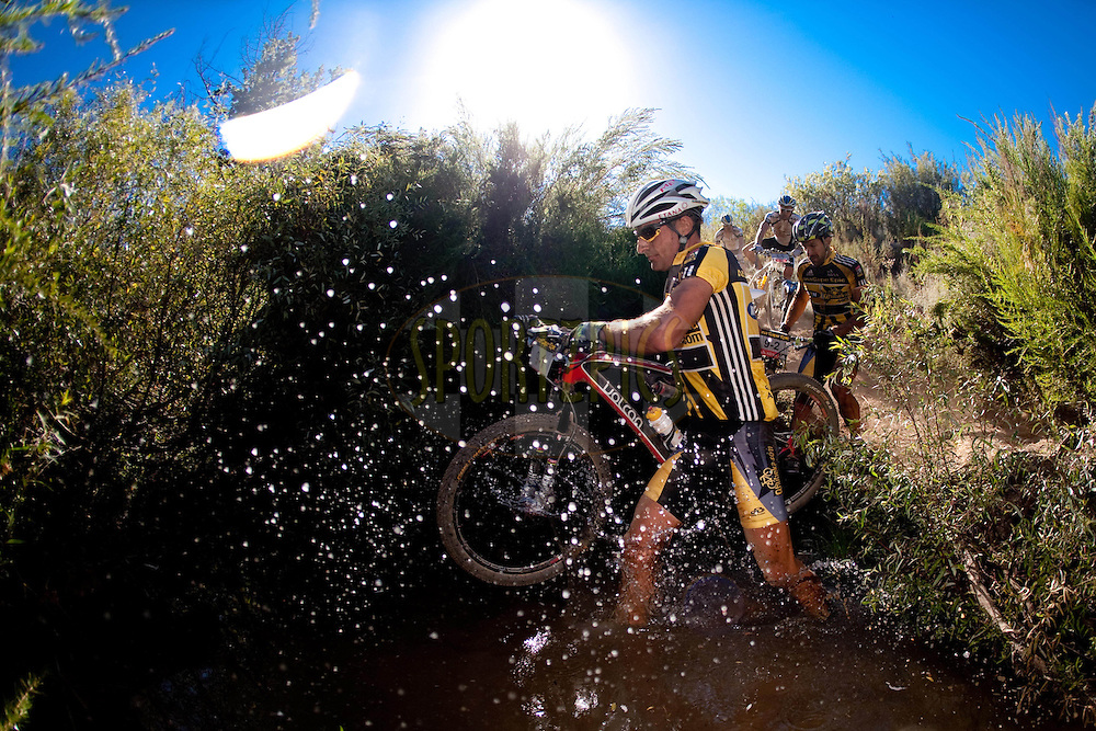 Kevin Evans and Alban Lakata make their way across a river during stage two of the 2010 Absa Cape Epic Mountain Bike stage race from Ceres to Ceres in the Western Cape, South Africa on the 22 March 2010.Photo by Karin Schermbrucker/SPORTZPICS.Photo by Karin Schermbrucker/SPORTZPICS