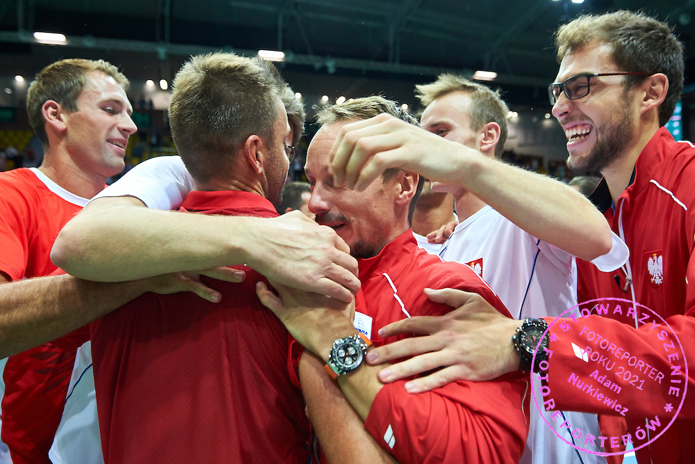 Michal Przysiezny celebrates his victory with team mates (L-R) Lukasz Kubot and Radoslaw Szymanik - captain national team and Kamil Gajewski and Jerzy Janowicz all from Poland during Davis Cup Tie World Group Play-off Poland v Slovakia at Gdynia Arena Hall in Gdynia, Poland.<br /> <br /> Poland, Gdynia, September 20, 2015<br /> <br /> Picture also available in RAW (NEF) or TIFF format on special request.<br /> <br /> For editorial use only. Any commercial or promotional use requires permission.<br /> <br /> Adam Nurkiewicz declares that he has no rights to the image of people at the photographs of his authorship.<br /> <br /> Mandatory credit:<br /> Photo by &copy; Adam Nurkiewicz / Mediasport